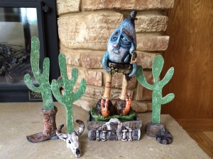 This is one of the first pieces I made after arrival to San Antonio from North Carolina.  It's a giant tear with more tears with more tears. He's wearing a cowboy hat and a huge belt buckle with 'Texas' engraved upon it. All while being  poised on top of the Alamo. Surrounded by cacti, a boot, a bleached bull skull, and Davy Crockett's hat.  This cry baby is wearing snails for shoes and he holds an empty beer bottle.  I really am enjoying Texas.  I think moving for anybody can be tricky.  Especially when you are leaving behind a job that you love along with your friends and family. There's such an element of excitement too.  I've come to the conclusion it takes at least a year to adjust to a new city.  This sculpture epitomizes how I felt after arrival here...it was just something I had to go through.
