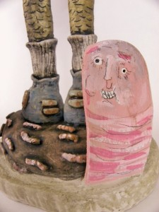 detail of the base of piece.  This is one of the three wooden earthworms that are coming out from the cement ground that the main character is standing upon.